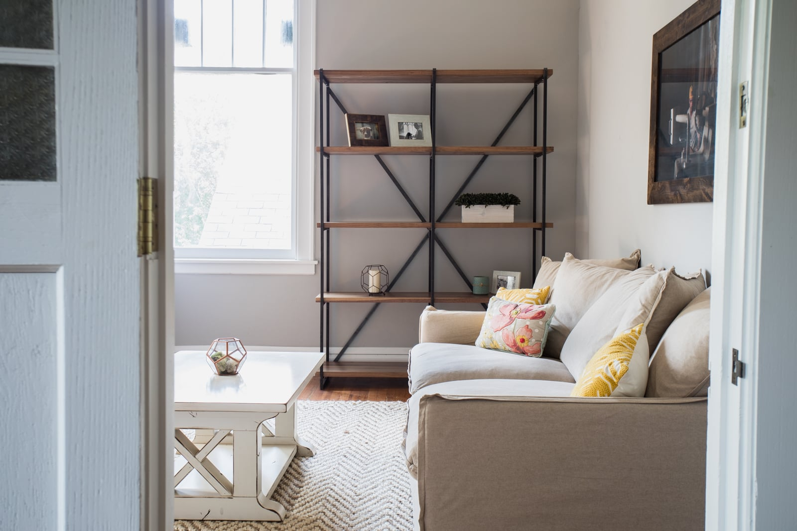 A Metal Bookcase by Unruh complements a living room